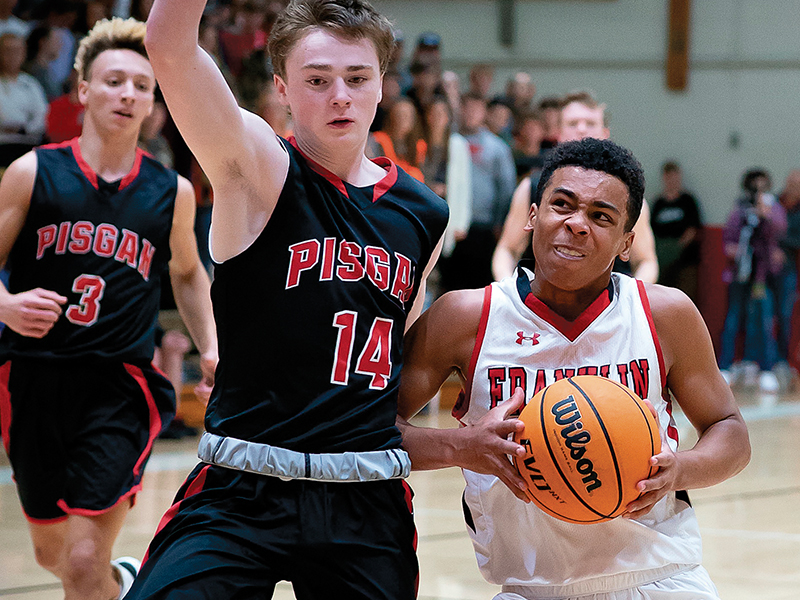 Press photos/Tom Pantaleo - Chad Wilson drives to the hoop while Pisgah's Max Wait tries to cut him off during action Friday. Franklin avenged a 53-30 loss to the Black Bears by winning another low-scoring battle, 46-43.