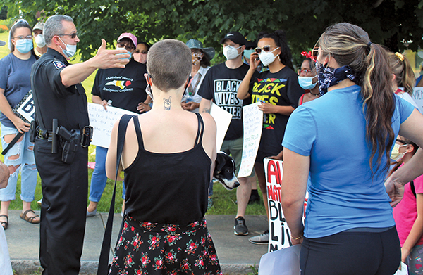 Press photo/Jake Browning - Franklin Police Chief Bill Harrell talks with protestors before the second Black Lives Matter rally in Franklin.