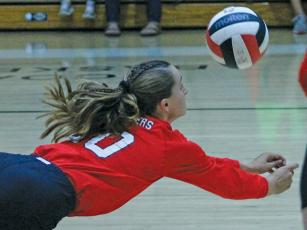 Press photo/Andy Scheidler Sophomore Kendall Reis dives for a dig during junior varsity action Sept. 26 against Hendersonville.  The Panthers went 20-1 this season, suffering a lone loss to conference foe Brevard.