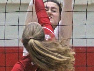 Press photo/Andy Scheidler - Franklin senior Maitlyn Rewis blocks a shot during Monday's semifinals match against Hendersonville. Rewis was one of three FHS players named to the all-tournament team.