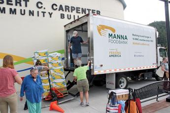 The Macon Program for Progress and MANNA Food Bank teamed up for another pop-up food bank on Monday.