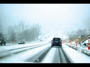 Press photo/Linda Mathias  - Saturday's snowfall quickly covered roads, triggering numerous accidents.