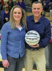 Photo provided - Franklin's all-time leading scorer Lindsay Simpson presented a 200 wins ball to coach Scott Hartbarger.