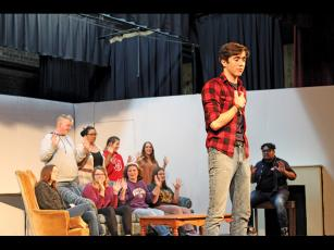 "Press photos/Jake Browning Tyler Martin delivers the opening monologue in ""The Plot, Like Gravy, Thickens."""