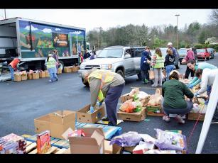 Press photo/Linda Mathias - MANNA's mobile food bank ran out of food on March 23 due to high demand.