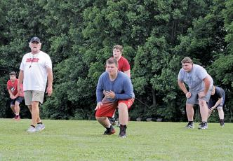 Photo courtesy Franklin Panther Sports Network - Assistant coach Greg Trawick oversees a limited workout for the Franklin High School football team on June 15.