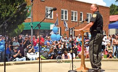 Press photo/Linda Mathias - Macon County Sheriff Robert Holland addresses the crowd that packed town square for the Back the Blue event.