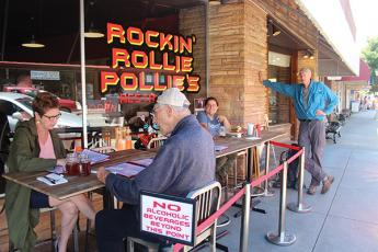 "Press photo/Jake Browning - Rockin' Rollie Pollies, in owner Roland Mock's words, welcomed customers back ""at 5:01 the day the governor said we could at 5"". From left, customers Amy Evans-Fisher, George Fisher, Virginia Brubeck and Phil Walker."