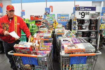 File photo - Randy Hughes, who heads up Smoky Mountain Toys for Tots, expects higher demand and less donations this year.