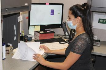 Press photo/Jake Browning - Ivonne Rios is in charge of medication assistance for the clinic