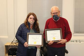 Press photo/Jake Browning - Stephanie MCall and Fred Goldsmith were presented with certificates of recognition of their work on the board.