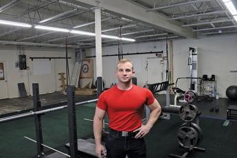 Downtown Fitness Training owner Rick Tarleton is pictured in his gym on West Palmer Street. Tarleton preempted the state's shutdown order this spring to protect his clients and trainers from COVID-19.