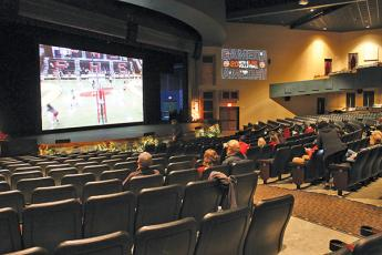 Press Photo/Will Woolever - Panther volleyball fans watch a recent game on the big screen at the Smoky Montain Center for the Performing Arts. The theater has been showing live broadcasts of FHS games for fans unable to attend.