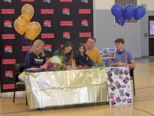 Press Photo/Will Woolever - FHS track and field standout Anna Tastinger signs her official offer from Montreat College as her mom, Julie; sister, Matilda; dad, John; and brother, John II look on.