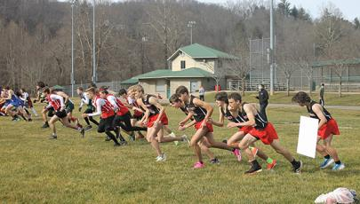 Press Photo/Will Woolever - The Franklin boys cross country team (black shirts) gets off the line at the Mountain Six Conference Championship meet in Cullowhee Jan. 6. The team qualified for its fourth straight state championship meet after fininshing second at the 2-A West Regional meet Jan. 15