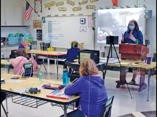 Press photo/Linda Mathias - Kim Clark teaches her third-grade class at East Franklin Elementary with nine students in the classroom and six joining in online.