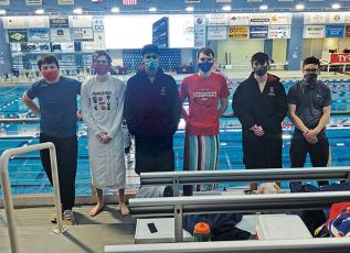 Press Photo/Will Woolever - Franklin Boys Swim Team members (from left) Kyler Cochran, Luke Borgmann, Michael Frazier, Caden Tyler, Clayton Guynn, and Hunter Cabe are pictured at the NCHSAA Championship Swim meet Feb. 12. Franklin tied for 20th out of 28 teams statewide.