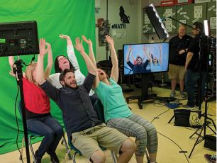 Photo submitted - Backlot Cinema teamed up with the Macon County Schools STEM program for a unit on video technology and production careers, demonstrated here with the use of a green screen.