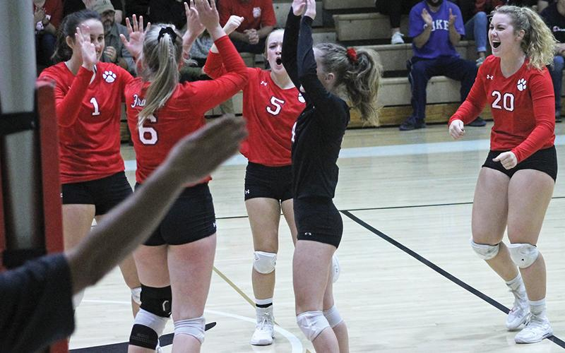 Press photos/Andy Scheidler - With the official's arm signaling the last point, players on Franklin's volleyball team celebrate winning the first set Saturday against Draughn. From left: Maitlyn Rewis, Alison Knop, Adrianne Duvall, Rhiley Bryson, Taylor Carlton.