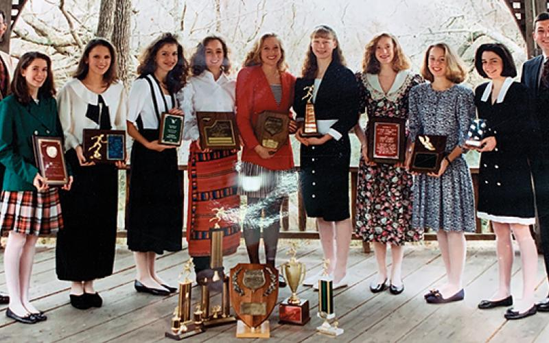 Photo submitted - The 1992 girls cross country team proudly displayed their plaques and trophies garnered during their state-championship winning season. From left: assistant coach Steve Philo, Amy Berger, Stephanie Hyder, Kristy Henson, Nikki Pons, Corie Fuchs, Marla Getford, Erica Riendeau, Jennifer Wiggins, Jessa Brown, head coach David Morgan. Not pictured: Emily Beller, Derrah Ledford.