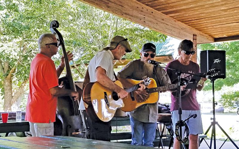 Photo submitted - Local musicians (from left) Ron Van Beuning, Chuck Dorling, Jay Baird, Dave Stewart play a concert under the Big Bear shelter at the Little Tennessee River Greenway recently. For the past few months Macon Music has hosted weekly music gatherings at the greenway.