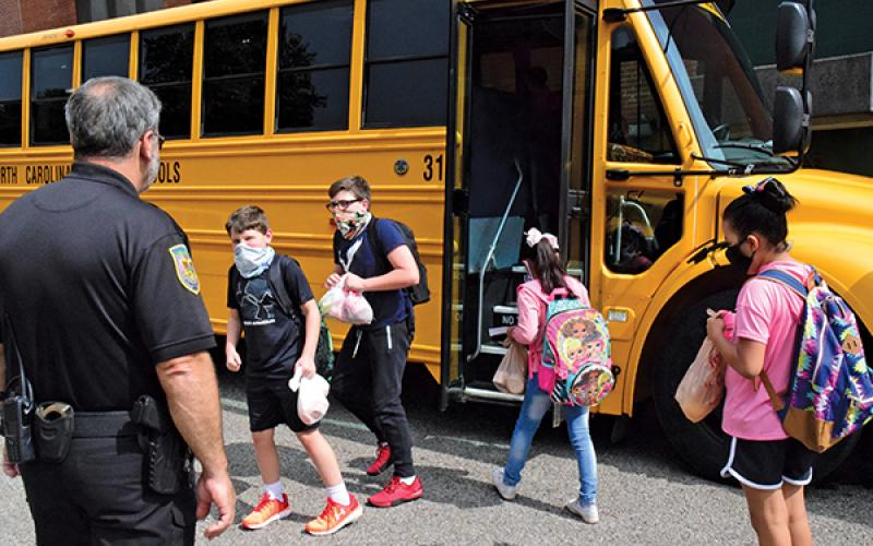 Press photo/Linda Mathias - Tom Pruett, school resource officer at East Franklin Elementary, watches as students board buses.