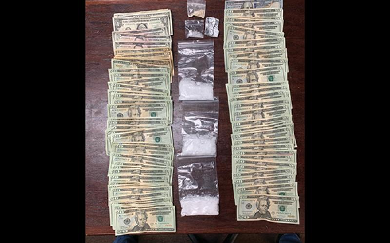 Photo submitted - Officers seized $1,700 in cash, 90 grams of methamphetamine and six grams of heroin.