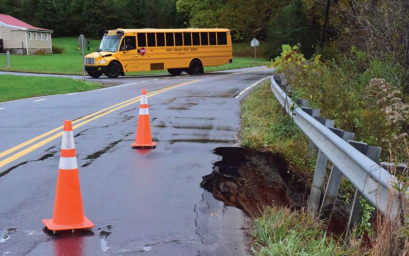 Press photo/Linda Mathis - A school bus takes a detour around a damaged section of Wells Grove Road.